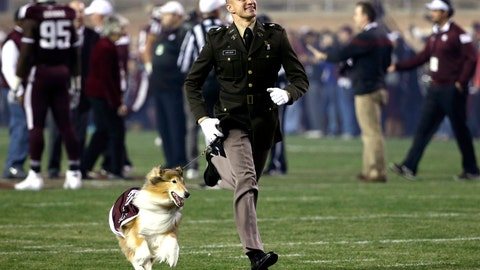 <p>               File-This Nov. 27. 2014, file photo shows Texas A&M cadet Ryan Kreider running onto the field with mascot Reveille VIII before an NCAA college football game against LSU in College Station, Texas.  A service has been scheduled Aug. 30 at Kyle Field to remember late Texas A&M collie mascot Reveille VIII. Organizers say Reveille VIII will be laid to rest 10 years to the day from her debut as mascot. The revered 12-year-old dog had been ill and died June 25. Reveille VIII drew avoidance attention on Sept. 20, 2014, as then-A&M cadet handler Kreider  deflected SMU receiver Der'rikk Thompson away from the dog. Kreider gained fame for throwing himself in front of the out-of-bounds player. Kreider has been invited to attend the service this month outside the north end of Kyle Field. (AP Photo/David J. Phillip, File)             </p>