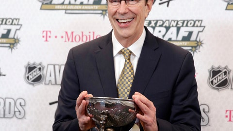<p>               FILE - In this June 21, 2017, file photo, David Poile, general manager of the Nashville Predators, poses with the NHL General Manager of the Year Award after winning the honor at the NHL Awards in Las Vegas. Poile headlines the 2018 class of the U.S. Hockey Hall of Fame. (AP Photo/John Locher, File)             </p>