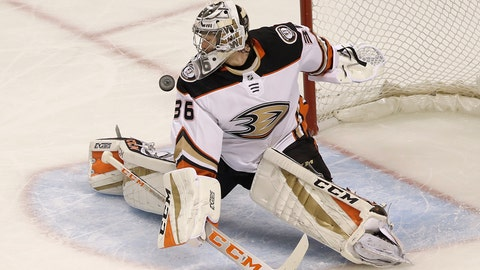 <p>               File-This April 18, 2018, file photo shows Anaheim Ducks goalie John Gibson (36) against the San Jose Sharks during the first period of Game 4 of an NHL hockey first-round playoff series in San Jose, Calif. Gibson agreed to an eight-year, $51.2 million extension with the Ducks on Saturday, keeping him with his only NHL club through the 2026-27 season. The Pittsburgh native was due to be a restricted free agent next summer after making $2.3 million in the upcoming season. His new contract has an average annual value of $6.4 million, putting him among the top-earning goalies in the league.  (AP Photo/Jeff Chiu, File)             </p>