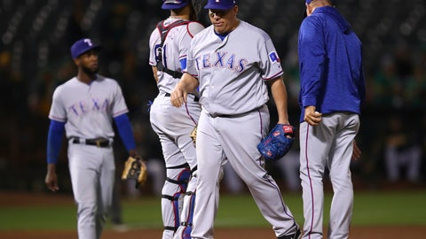 <p>               Texas Rangers' Bartolo Colon, center, walks off the mound after being relieved by manager Jeff Banister, right, in the sixth inning of a baseball game against the Oakland Athletics, Monday, Aug. 20, 2018, in Oakland, Calif. (AP Photo/Ben Margot)             </p>