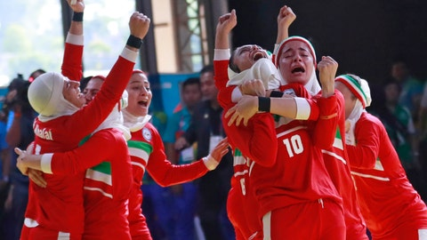 <p>               Iran's Kabaddi team react after defeating India during the women's gold medal match at the 18th Asian Games in Jakarta, Indonesia, Friday, Aug. 24, 2018. (AP Photo/Tatan Syuflana)             </p>