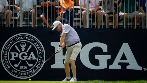 <p>               Craig Bowden hits on the driving range during a practice round for the PGA Championship golf tournament at Bellerive Country Club, Wednesday, Aug. 8, 2018, in St. Louis. (AP Photo/Charlie Riedel)             </p>