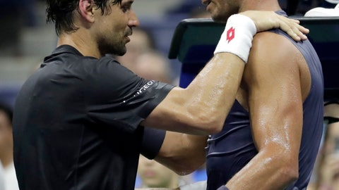 <p>               David Ferrer, left, of Spain, talks to Rafael Nadal, also of Spain, after Ferrer retired from their first-round match at the U.S. Open tennis tournament, Monday, Aug. 27, 2018, in New York. (AP Photo/Julio Cortez)             </p>