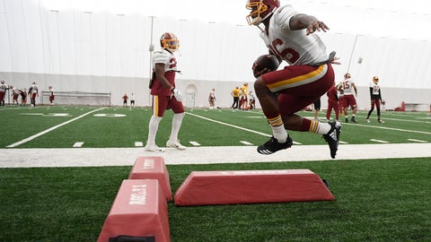 <p>               Washington Redskins running back Adrian Peterson runs with the ball during an NFL football team practice, Tuesday, Aug. 21, 2018, in Ashburn, Va. (AP Photo/Nick Wass)             </p>