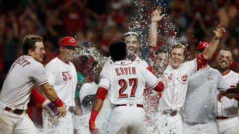 <p>               Cincinnati Reds' Phillip Ervin (27) is sprayed with water as he crosses home plate with a walk-off home run off San Francisco Giants relief pitcher Ray Black during the 11th inning of a baseball game Friday, Aug. 17, 2018, in Cincinnati. The Reds won 2-1. (AP Photo/Gary Landers)             </p>