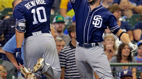 <p>               San Diego Padres' Hunter Renfroe, left, gets a high-five from Austin Hedges after Renfroe's grand slam against the Milwaukee Brewers during the ninth inning of a baseball game Thursday, Aug. 9, 2018, in Milwaukee. (AP Photo/Jeffrey Phelps)             </p>