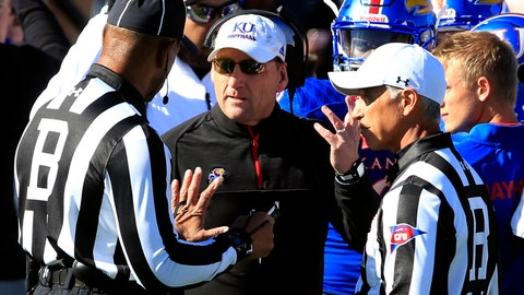 <p>               FILE - In this Oct. 28, 2017, file photo, Kansas head coach David Beaty, second from left, talks with a game official during the first half of an NCAA college football game against Kansas State in Lawrence, Kan. Beaty was practically set up to the fail in his first head coaching job. The Jayhawks' roster had been left woefully depleted by Charlie Weis and KU was looking for someone to clean up the mess on the relative cheap. Still, three wins in three seasons means trouble for the coach. (AP Photo/Orlin Wagner, File)             </p>