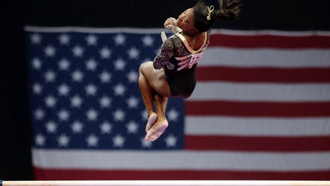 <p>               Simone Biles competes on the uneven bars at the U.S. Gymnastics Championships, Friday, Aug. 17, 2018, in Boston. (AP Photo/Elise Amendola)             </p>