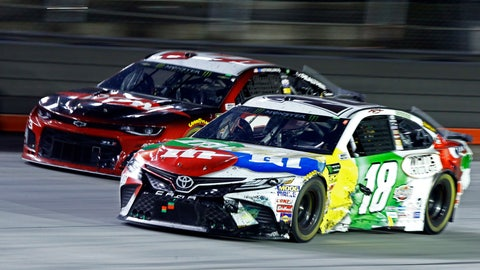 <p>               Kyle Busch (18) gets past Austin Dillon during the NASCAR Cup Series auto race, Saturday, Aug. 18, 2018, in Bristol, Tenn. (AP Photo/Wade Payne)             </p>