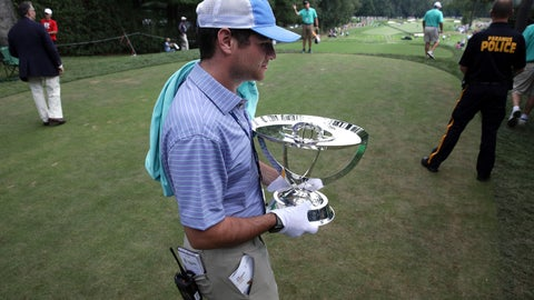 <p>               Zach Rosen carries the winner's trophy from the first tee box during the final round of the Northern Trust golf tournament, Sunday, Aug. 26, 2018, in Paramus, N.J. (AP Photo/Mel Evans)             </p>