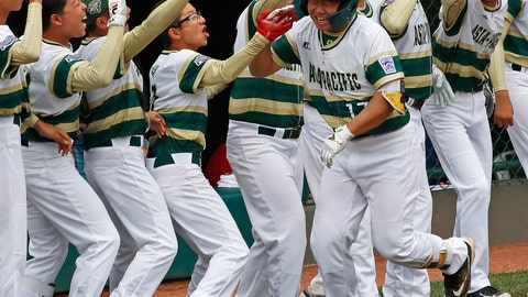 <p>               South Korea's Ji Hying Choi (17) celebrates with teammates as he returns to the dugout after hitting a solo home run off Japan's Shisei Fujimoto in the first inning of the International Championship baseball game at the Little League World Series tournament, Saturday, Aug. 25, 2018, in South Williamsport, Pa. (AP Photo/Tom E. Puskar)             </p>