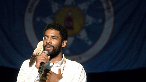 <p>               Boston Celtic point guard Kyrie Irving, with an eagle feather tied to his hair, tells the crowd gathered how gratified he is for the welcome he and his older sister, Asia Irving, have received during a naming ceremony in their honor, Thursday, Aug. 23, 2018 at the Prairie Knights Casino north of Fort Yates, N.D. on the Standing Rock Sioux Indian Reservation. Irving's mother, Elizabeth Larson, was an enrolled member of the tribe before being adopted as a youngster. Irving was named Little Mountain by the tribe. (Mike McCleary/The Bismarck Tribune via AP)             </p>