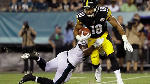 <p>               Pittsburgh Steelers' Justin Thomas (18) is tackled by Philadelphia Eagles' Jeremy Reaves (41) during the second half of a preseason NFL football game Thursday, Aug. 9, 2018, in Philadelphia. (AP Photo/Matt Rourke)             </p>