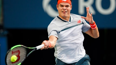 <p>               Canada's Milos Raonic returns a shot David Goffin of Belgium during the first round of the Men's Rogers Cup tennis tournament in Toronto, Monday Aug. 6, 2018. (Mark Blinch/The Canadian Press via AP)             </p>
