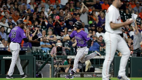 <p>               Colorado Rockies' Nolan Arenado (28) is congratulated by third base coach Stu Cole (39) after hitting a two-run home run off Houston Astros starting pitcher Justin Verlander, right, during the sixth inning of a baseball game Tuesday, Aug. 14, 2018, in Houston. (AP Photo/David J. Phillip)             </p>