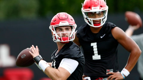 <p>               File-This Aug. 3, 2018, file photo shows Georgia quarterback Jake Fromm (11) throwing a pass as freshman quarterback Justin Fields (1) looks on during their NCAA college football training camp practice in Athens, Ga. Fields is competing with Fromm, whose composure as a freshman starter in 2017 was a big key in the Bulldogs winning their first Southeastern Conference championship since 2005 and advancing to the national championship game. In each of the last two years, the new kid won the starting job after only one game.  (AP Photo/John Bazemore, File)             </p>
