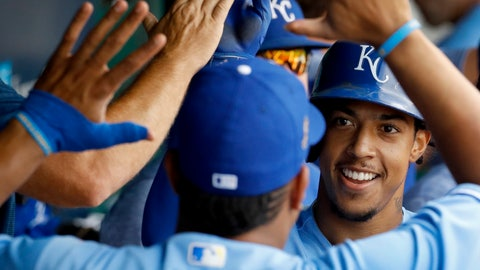<p>               Kansas City Royals' Adalberto Mondesi celebrates with Salvador Perez in the dugout after hitting a two-run home run during the second inning of a baseball game against the Detroit Tigers Wednesday, Aug. 29, 2018, in Kansas City, Mo. (AP Photo/Charlie Riedel)             </p>