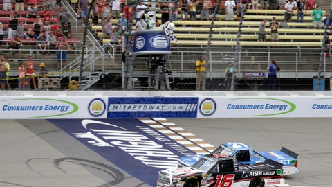 <p>               Brett Moffitt (16) wins the NASCAR Camping World Truck Series Corrigan Oil 200 just ahead of Johnny Sauter (21) at Michigan International Speedway, Saturday, Aug. 11, 2018, in Brooklyn, Mich. (Nikos Frazier/Jackson Citizen Patriot via AP)             </p>
