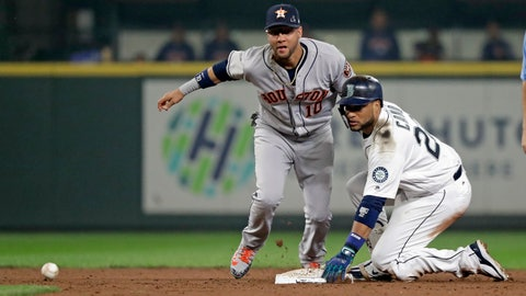 <p>               Houston Astros second baseman Yuli Gurriel, left, and Seattle Mariners' Robinson Cano eye the ball after Cano arrived at second base on his double in the sixth inning of a baseball game, Monday, Aug. 20, 2018, in Seattle. (AP Photo/Elaine Thompson)             </p>