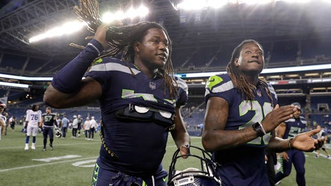 <p>               Seattle Seahawks twin brothers linebacker Shaquem Griffin, left, and cornerback Shaquill Griffin leave the field following the team's NFL football preseason game against the Indianapolis Colts, Thursday, Aug. 9, 2018, in Seattle. The Colts won 19-17. (AP Photo/Stephen Brashear)             </p>