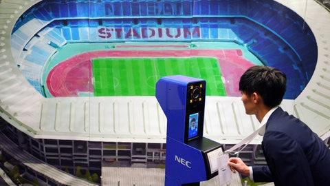 <p>               A staff demonstrates a new face recognition system used for the Tokyo 2020 Olympic and Paralympic Games during a press conference in Tokyo Tuesday, Aug. 7, 2018. The NeoFace technology developed by NEC Corp. will be used across the Olympics for the first time as Tokyo organizers work to keep security tight and efficient at dozens of venues during the 2020 Games. (AP Photo/Eugene Hoshiko)             </p>