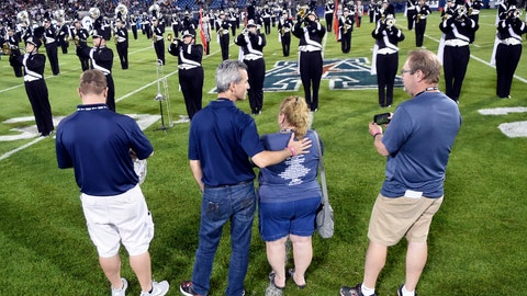 <p>               Max Schachter, second from left, the father of Alex Schachter, who was killed in the February shooting at Marjory Stoneman Douglas High School, watches the Connecticut marching band play during the halftime show dedicated to his son at an NCAA college football game, Thursday, Aug. 30, 2018, in East Hartford, Conn. From left are, Tim Goldberg, Alex's cousin; Schachter; Patti Goldberg, aunt; and Paul Goldberg, uncle. (AP Photo/Stephen Dunn)             </p>