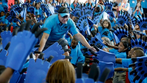 "<p>               Carolina Panthers owner David Tepper greets students during a ""kickoff rally"" at Thomasboro Academy in Charlotte, N.C., Tuesday, Aug. 28, 2018. Tepper's charitable foundation along with several players groups and other partners will provide over 12,000 backpacks full of supplies to 17 elementary schools in Charlotte-Mecklenburg Schools, as well as an additional school in Kannapolis City Schools. (AP Photo/Chuck Burton)             </p>"