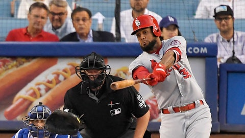 <p>               St. Louis Cardinals' Jose Martinez, right, hits a solo home run as Los Angeles Dodgers catcher Austin Barnes, left, watches along with home plate umpire Sam Holbrook during the first inning of a baseball game Monday, Aug. 20, 2018, in Los Angeles. (AP Photo/Mark J. Terrill)             </p>