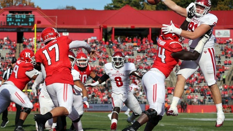 <p>               FILE - In this Nov. 5, 2016, file photo, Indiana defensive lineman Jacob Robinson (91) gets a hand up to block as Rutgers quarterback Giovanni Rescigno (17) throws a pass during the second half of an NCAA college football game in Piscataway, N.J. Robinson should move into a starting spot after recording four sacks last season. (AP Photo/Mel Evans, File)             </p>