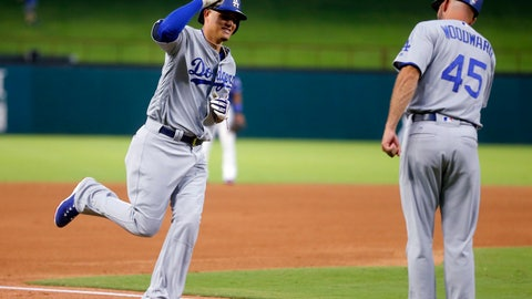 <p>               Los Angeles Dodgers' Manny Machado (8) celebrates his solo home run against the Texas Rangers with third base coach Chris Woodward (45), during the fourth inning of a baseball game Wednesday, Aug. 29, 2018, in Arlington, Texas. (AP Photo/Michael Ainsworth)             </p>