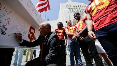 <p>               University of Southern California head coach Clay Helton signs the final beam, as players look on, in front of the Los Angeles Memorial Coliseum in Los Angeles, Wednesday, Aug. 15, 2018. Although the 95-year-old Los Angeles Memorial Coliseum is only about halfway through its two-year, $300 million renovation project, the Rams and the Trojans have football games to play. The venerable stadium that hosted two Olympics and the first Super Bowl will be open to the public again this weekend with new amenities in the famed concrete bowl. (AP Photo/Chris Carlson)             </p>