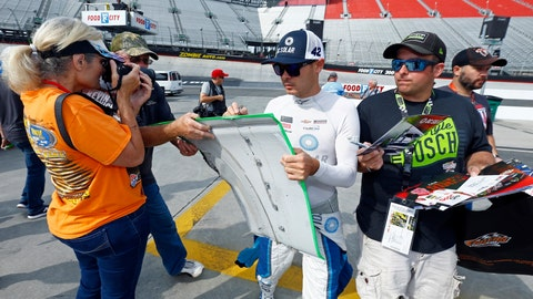 <p>               Kyle Larson signs autographs before practice for a NASCAR Cup Series auto race, Friday, Aug. 17, 2018, in Bristol, Tenn. (AP Photo/Wade Payne)             </p>
