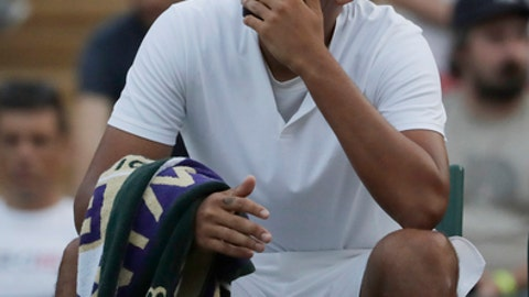 Nick Kyrgios of Australia sits in his chair in a game break during the men's singles match against Kei Nishikori of Japan on the sixth day at the Wimbledon Tennis Championships in London, Saturday July 7, 2018. (AP Photo/Ben Curtis)