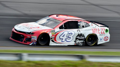 Bubba Wallace drives through Turn 1 during a NASCAR Cup Series auto race, Sunday, July 29, 2018, in Long Pond, Pa. Kyle Busch won the race. (AP Photo/Derik Hamilton)