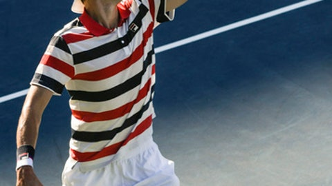 John Isner serves against Ryan Harrison during the finals of the BB&T Atlanta Open tennis tournament Sunday, July 29, 2018, in Atlanta. Isner won. (AP Photo/John Amis)