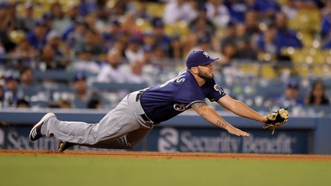 Milwaukee Brewers third baseman Mike Moustakas makes a catch on a ball hit by Los Angeles Dodgers' Enrique Hernandez during the eighth inning of a baseball game Monday, July 30, 2018, in Los Angeles. Hernandez was thrown out at first on the play. Milwaukee won 5-2. (AP Photo/Mark J. Terrill)