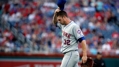 New York Mets starting pitcher Steven Matz scratches his head as he walks to the dugout after being relieved during the first inning of the team's baseball game against the Washington Nationals at Nationals Park, Tuesday, July 31, 2018, in Washington. (AP Photo/Alex Brandon)