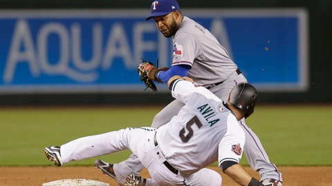 Texas Rangers shortstop Elvis Andrus gets the force out on Arizona Diamondbacks Alex Avila (5) on a ball hit by Zack Godley, who was safe at first during the fourth inning during a baseball game Tuesday, July 31, 2018, in Phoenix. (AP Photo/Rick Scuteri)