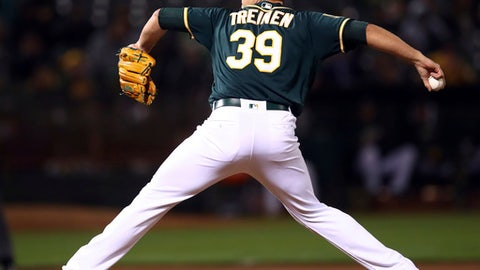 Oakland Athletics pitcher Blake Treinen works against the Toronto Blue Jays during the ninth inning of a baseball game Tuesday, July 31, 2018, in Oakland, Calif. (AP Photo/Ben Margot)