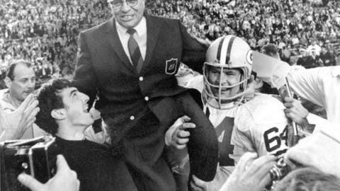 FILE - In this Jan. 14, 1968, file photo, Green Bay Packers coach Vince Lombardi is carried off the field after his team defeated the Oakland Raiders 33-14 in Super Bowl II in Miami, Fla. Packers guard Jerry Kramer (64) is at right. Kramer will be inducted into the Pro Football Hall of Fame on Saturday, Aug. 4, 2018, in Canton, Ohio.(AP Photo/File)