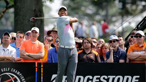 FILE - In this July 31, 2014, file photo, Tiger Woods watches his tee shot on the ninth hole during the first round of the Bridgestone Invitational golf tournament at Firestone Country Club in Akron, Ohio. The biggest win for Tiger Woods this year was simply getting a chance to play. He narrowly qualified for the Bridgestone Invitational,  which is being held for the last time on the Firestone course where Woods has won eight times. (AP Photo/Mark Duncan, File)