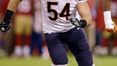 FILE - In this Nov. 19, 2012, file photo, Chicago Bears middle linebacker Brian Urlacher chases a play against the San Francisco 49ers during the second half of an NFL football game in San Francisco. Urlacher will be inducted into the Hall of Fame on on Saturday, Aug. 4, 2018.   (AP Photo/Marcio Jose Sanchez, File)