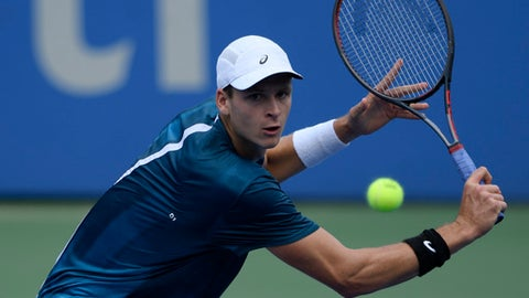Hubert Hurkacz, of Poland, eyes a return against Frances Tiafoe during the Citi Open tennis tournament, Wednesday, Aug. 1, 2018, in Washington. (AP Photo/Nick Wass)