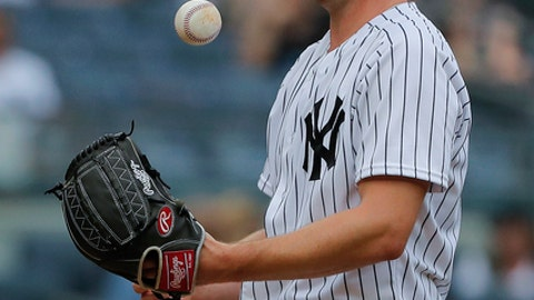 New York Yankees starting pitcher Sonny Gray flips the ball after giving up an RBI double to Baltimore Orioles' Renato Nunez during the second inning of a baseball game, Wednesday, Aug. 1, 2018, in New York. (AP Photo/Julie Jacobson)