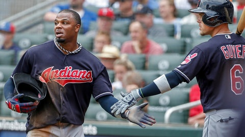 Cleveland Indians Rajai Davis celebrates scoring with Brandon Guyer (6) against the Minnesota Twins in the sixth inning of a baseball game Wednesday, Aug. 1, 2018, in Minneapolis. (AP Photo/Bruce Kluckhohn)