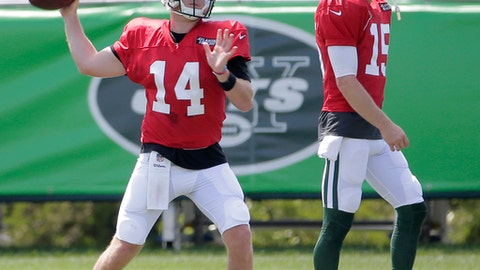 New York Jets quarterback Sam Darnold, left, throws while quarterback Josh McCown looks on during practice at the NFL football team's training camp in Florham Park, N.J., Wednesday, Aug. 1, 2018. (AP Photo/Seth Wenig)