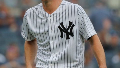 New York Yankees starting pitcher Sonny Gray, left, reacts as he leaves the game during the third inning of a baseball game against the Baltimore Orioles, Wednesday, Aug. 1, 2018, in New York. The Orioles won 7-5. (AP Photo/Julie Jacobson)
