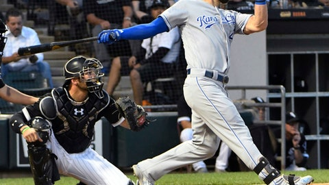 Kansas City Royals' Alex Gordon (4) watches his two-run double against the Chicago White Sox during the third inning of a baseball game Wednesday, Aug. 1, 2018, in Chicago. (AP Photo/David Banks)