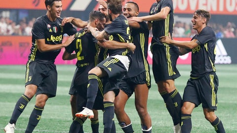 Juventus defender Mattia De Sciglio (2) celebrates with his teammates after scoring the winning goal in penalties during the MLS All-Star soccer match against the MLS All-Stars, Wednesday, Aug. 1, 2018, in Atlanta. (AP Photo/John Bazemore)