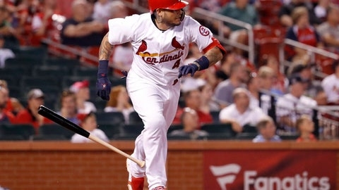 St. Louis Cardinals' Yadier Molina watches his two-run double during the eighth inning of the team's baseball game against the Colorado Rockies on Wednesday, Aug. 1, 2018, in St. Louis. (AP Photo/Jeff Roberson)
